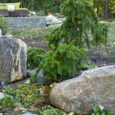 drilled granite bubbling boulder