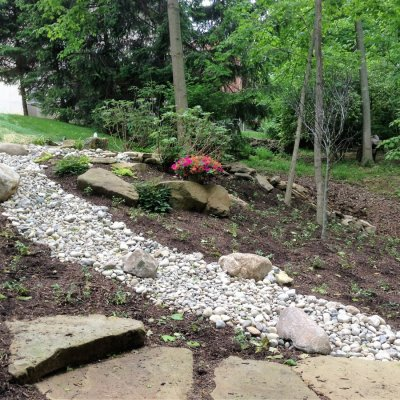 Landscape Design with Sandstone Walkway and Dry Creek Bed