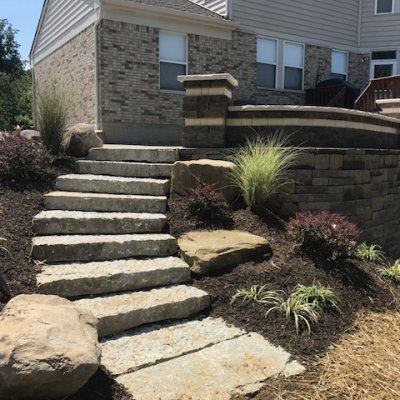 Stone Steps leading to a paver patio
